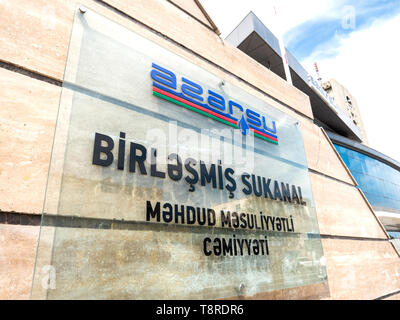 Baku, Azeirbaijan - May 1, 2019: Azersu logotype on the facade of the building. Open Joint Stock Company is in charge of policy and strategy for the water supply and sanitation services in Azerbaijan - Stock Photo