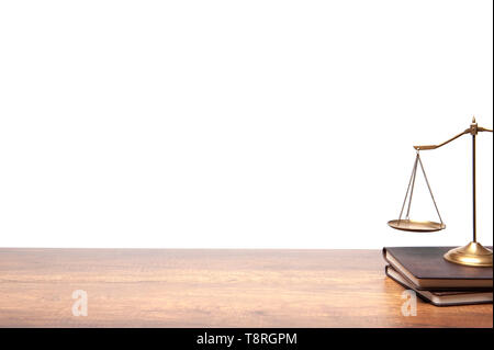 Gold brass balance scale placed on the vintage books and wood table on white background, legal law concept. - Stock Photo