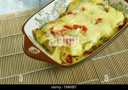 Creamy Pepperjack Chicken Enchiladas, loaded with enchilada sauce, sour cream - Stock Photo