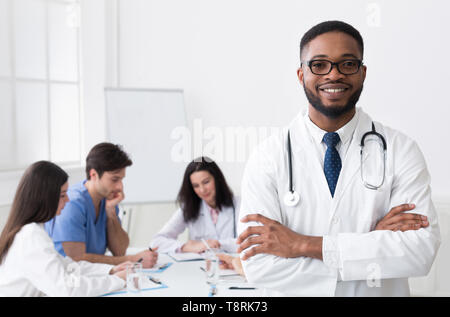 African Medical Doctor Looking At Camera During Conference - Stock Photo
