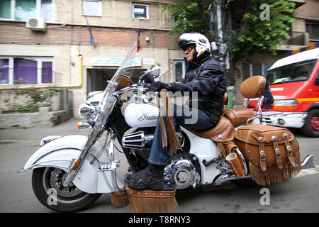 Bucharest, Romania - May 14, 2019: Biker riding an Indian motorcycle. - Stock Photo