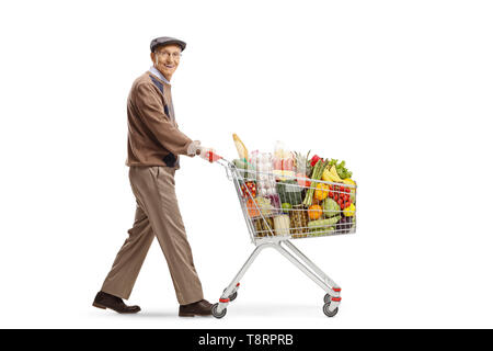Full length shot of an elderly man pushing a shopping cart and looking at the camera isolated on white background - Stock Photo