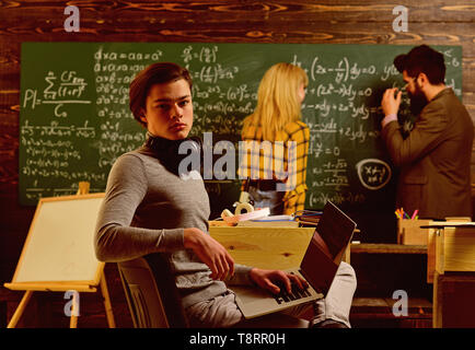 People learning education and school concept - students hands with books or textbooks writing. Student writing composition for annual exams - Stock Photo