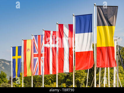 Flags of some of the Member States, including the United Kingdom, of the European Union against a blue sky - Stock Photo