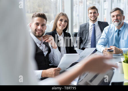 Businesswoman Leads Meeting Around Table. Discussion Talking Sharing Ideas Concept. - Stock Photo
