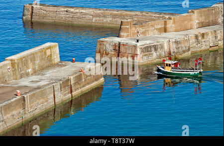 PORTKNOCKIE MORAY SCOTLAND SMALL CRAB BOAT LOADED WITH CREELS LEAVING THE HARBOUR - Stock Photo