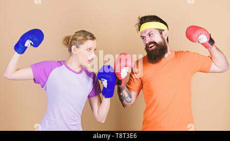 Pain is temporary, Pride is forever. training with coach. Happy woman and bearded man workout in gym. sportswear. Fight. knockout and energy. couple training in boxing gloves. punching, sport Success. - Stock Photo