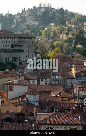 Landscape aerial view of the nice city of Bergamo Alta in Northern Italy, an old  perched town surrounded by flatland - Stock Photo