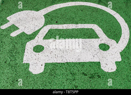 Green electric car parking sign, painted on asphalt - Stock Photo