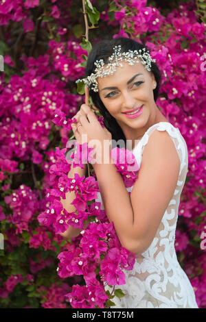 Blooming beauty. Bride white wedding dress sunny day pink flowers bloom nature background. Botany themed wedding. Woman pretty dress wedding ceremony. Flowers wedding decorations. Florist service. - Stock Photo