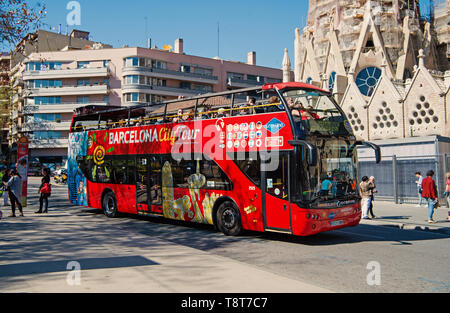 Barcelona, Spain - March 30, 2016: Barcelona city tour bus on street. Sightseeing and travelling. Transport for trip around Barcelona. Summer vacation in Barcelona. - Stock Photo