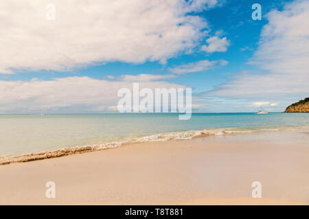 Idyllic scene sand tropic beach wave blue sea. Everyone should visit tropic resort st.johns antigua. Top list vacation resorts. Travel tropic island vacation. Stunning beauty tropic environment. - Stock Photo