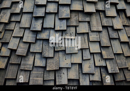 Full frame closeup of wooden shingles, worn, weathered with random patterns. - Stock Photo