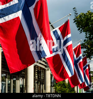 A Line Of Norwegian National Flags Blowing in the Breeze - Stock Photo