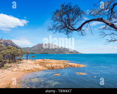A beach at Coles Bay, adjacent to Freycinet National Park in Tasmania, Australia. - Stock Photo