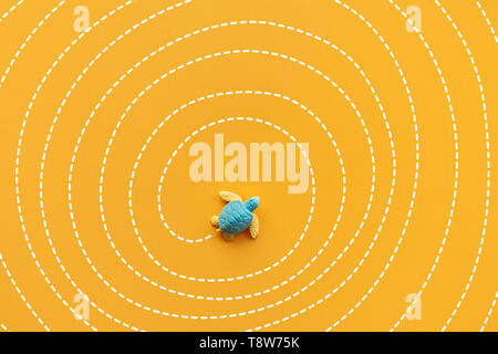 Solution and solving concepts with baby turtle moving on maze line.Smart direction for business situation - Stock Photo