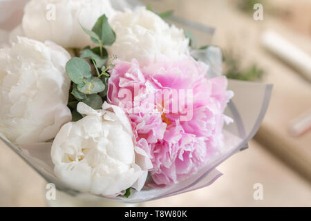 White and pink peonies in a metal vase. Beautiful peony flower for catalog or online store. Floral shop concept . Beautiful fresh cut bouquet. Flowers