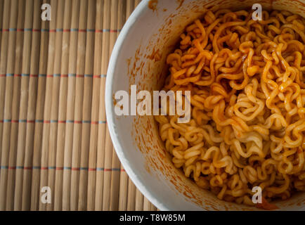 Bowl of Chinese ramen noodles with tomato ketchup. Top view. - Stock Photo