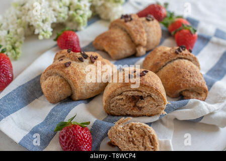fresh golden croissants with strawberries - Stock Photo