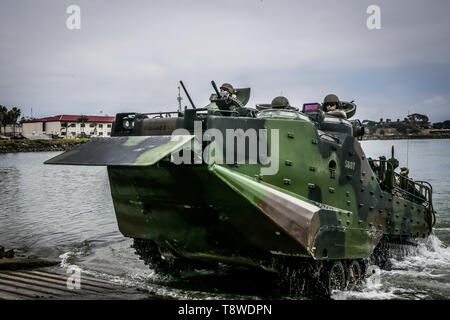 U.S. Marines with the Assault Amphibian School Battalion (AAS Bn.), Training Command, operate an AAV7 Assault Amphibious Vehicle (AAV) during water operations at the Del Mar boat basin on Marine Corps Base Camp Pendleton, California, May 13, 2019. The vehicle was operated by instructors with AAS Bn. during a period of instruction designed to explain the basic operations of the vehicle to students. (U.S. Marine Corps photo by Lance Cpl. Alison Dostie) - Stock Photo
