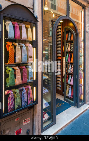 ROME, ITALY - SEPTEMBER 4, 2010: Colorful ties are on display at the entrance of the men's fashion store Marcello in the Via dei Condotti in Rome on s - Stock Photo