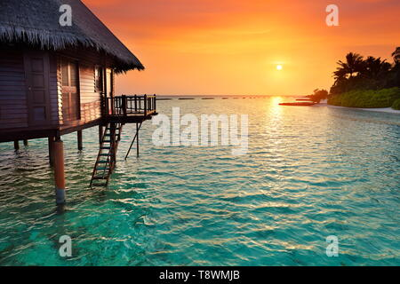 Sunset at tropical beach, Maldives Island landscape hotel - Stock Photo