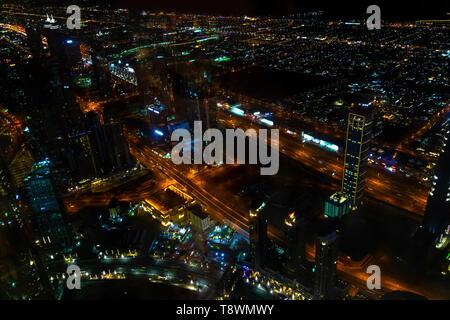 View from the Burj Khalifa tower at night Dubai. - Stock Photo