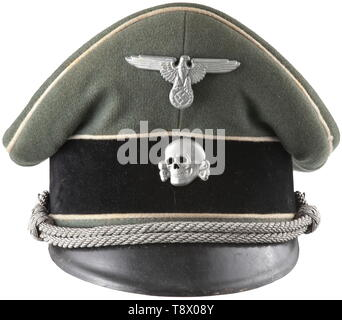 A visor cap for leaders in the Waffen-SS late-war issue Field-grey cloth, typical for officer caps of the Waffen-SS, black trim band, steel-grey imitation silk liner (with size stamping '55'), grey leather sweatband, visor of vulcanised fibre with grey underlay, light metal insignia, silver officer's cord. The shape of the cap is somewhat crumpled, apparently because the wearer had the habit of inserting the cap in his belt. historic, historical, 20th century, 1930s, 1940s, Waffen-SS, armed division of the SS, armed service, armed services, NS, National Socialism, Nazism, T, Editorial-Use-Only - Stock Photo