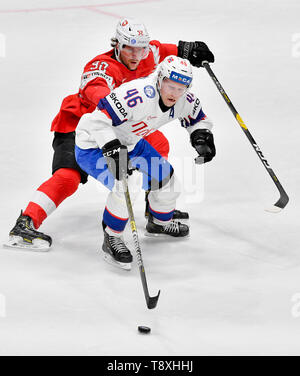 Bratislava, Slovakia. 15th May, 2019. Mathis Olimb (NOR), front, Gaetan Haas (SWE) in action during the match between Switzerland and Norway within the 2019 IIHF World Championship in Bratislava, Slovakia, on May 15, 2019. Credit: Vit Simanek/CTK Photo/Alamy Live News - Stock Photo