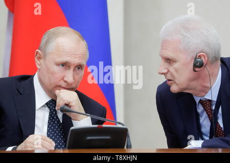 Sochi, Russia. 15th May, 2019. SOCHI, RUSSIA - MAY 15, 2019: Russia's President Vladimir Putin (L) and his aide Andrei Fursenko attend the inaugural meeting of the Sochi Dialogue Forum. Mikhail Metzel/TASS Credit: ITAR-TASS News Agency/Alamy Live News - Stock Photo