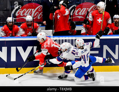 Bratislava, Slovakia. 15th May, 2019. L-R Nico Hischier (SWE) and Patrick Thoresen and Mathis Olimb (both NOR) in the match between Switzerland and Norway within the 2019 IIHF World Championship in Bratislava, Slovakia, on May 15, 2019. Credit: Vit Simanek/CTK Photo/Alamy Live News - Stock Photo