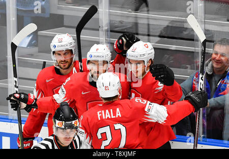Bratislava, Slovakia. 15th May, 2019. The author of the second goal Nico Hischier (CH), right, celebrates with his teammates in the match between Switzerland and Norway within the 2019 IIHF World Championship in Bratislava, Slovakia, on May 15, 2019. Credit: Vit Simanek/CTK Photo/Alamy Live News - Stock Photo