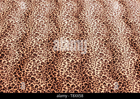 Close up of Leopard Spots Faux Fur Pattern Material - Stock Photo