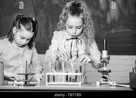 Chemistry equipment. students doing biology experiments with microscope in lab. Chemistry education. curious children. Chemistry lesson. Little kids learning chemistry in school. Professional choice. - Stock Photo