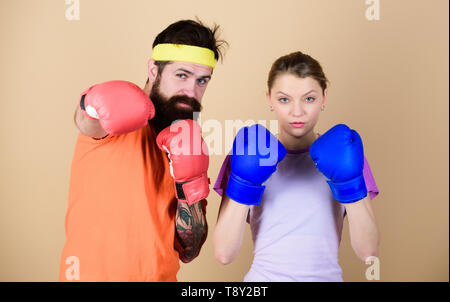 training with coach. sportswear. Fight. knockout and energy. couple training in boxing gloves. punching, sport Success. Happy woman and bearded man workout in gym. Hustle, hit and never quit. - Stock Photo