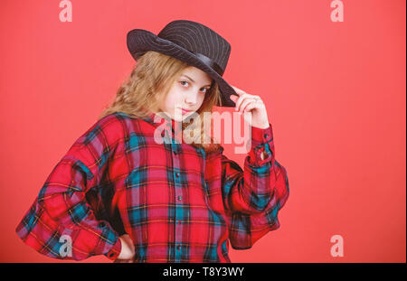Girl cute kid wear fashionable hat. Small fashionista. Cool cutie fashionable outfit. Happy childhood. Kids fashion concept. Check out my fashion style. Fashion trend. Feeling awesome in this hat. - Stock Photo
