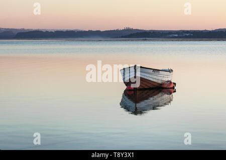 Small boat on the lagoon in Foz do Arelho, Portugal - Stock Photo