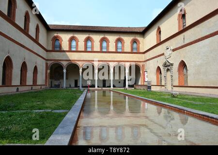 Milan/Italy - June 1, 2015: Ducal Court with internal ancient medieval arcades, reflected in the pool water of Sforza Castle, Sforzesco in Milan. - Stock Photo