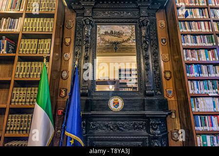 A mirror in an hall of the lhe library of Palazzo Salviati, now home to the Centro Alti Studi della Difesa, in Rome, Italy - Stock Photo