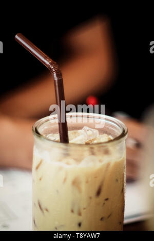Cold Brew Coffee Easy homemade cold brew iced coffee  relaxman working in office  blur background - Stock Photo