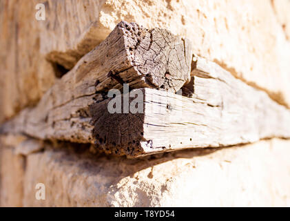 Old ancient white stone and wooden wall of Medieval cave city-fortress Chufut-Kale in the mountains, Bakhchisaray, Crimea on landscape view background - Stock Photo