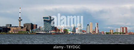 Rotterdam skyline and New Meuse river - shipping on Nieuwe Maas river and Rotterdam port - Netherlands economy - Dutch economy - Dutch commerce - Stock Photo