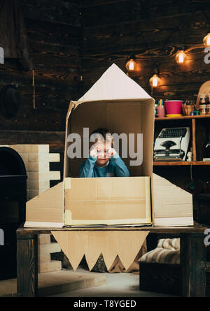 Earth day concept. earth day holiday with small kid in paper rocket. - Stock Photo