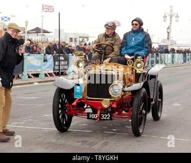 Evert  Louwman  driving 'Genevieve', a 1904 Darracq, across the finishing line of the 2018 London to Brighton Veteran Car Run. - Stock Photo