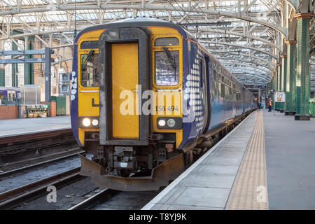 A Scotrail Class 156 diesel multiple unit train sits at platform 10 of Glasgow Central Station. - Stock Photo
