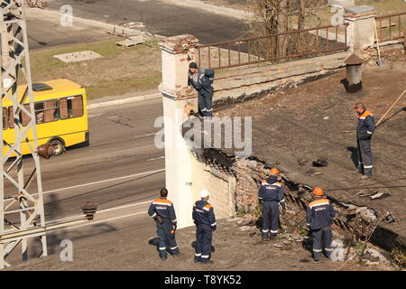Kremenchug, Poltava region, Ukraine, April 9, 2019, repair of the old roof of the building - Stock Photo