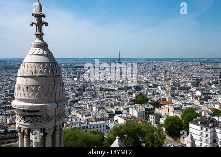 View of city skyline, with Eiffel Tower in distance, from top of Sacre-Coeur Basilica in Montmartre, Paris, France - Stock Photo