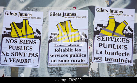 Political posters, Yellow Jackets movement, Lyon, France - Stock Photo
