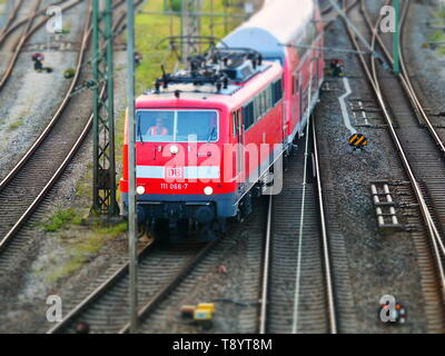 Augsburg, Germany - September 5, 2018: Red train from the German railway operator German railways Deutsche Bahn DB is leaving the central station in A - Stock Photo
