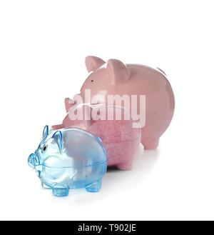 Piggy banks on white background - Stock Photo
